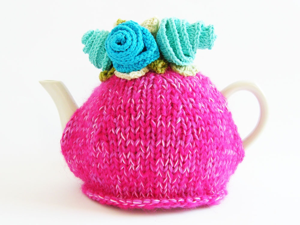 Hot pink knitted tea cosy with flowers