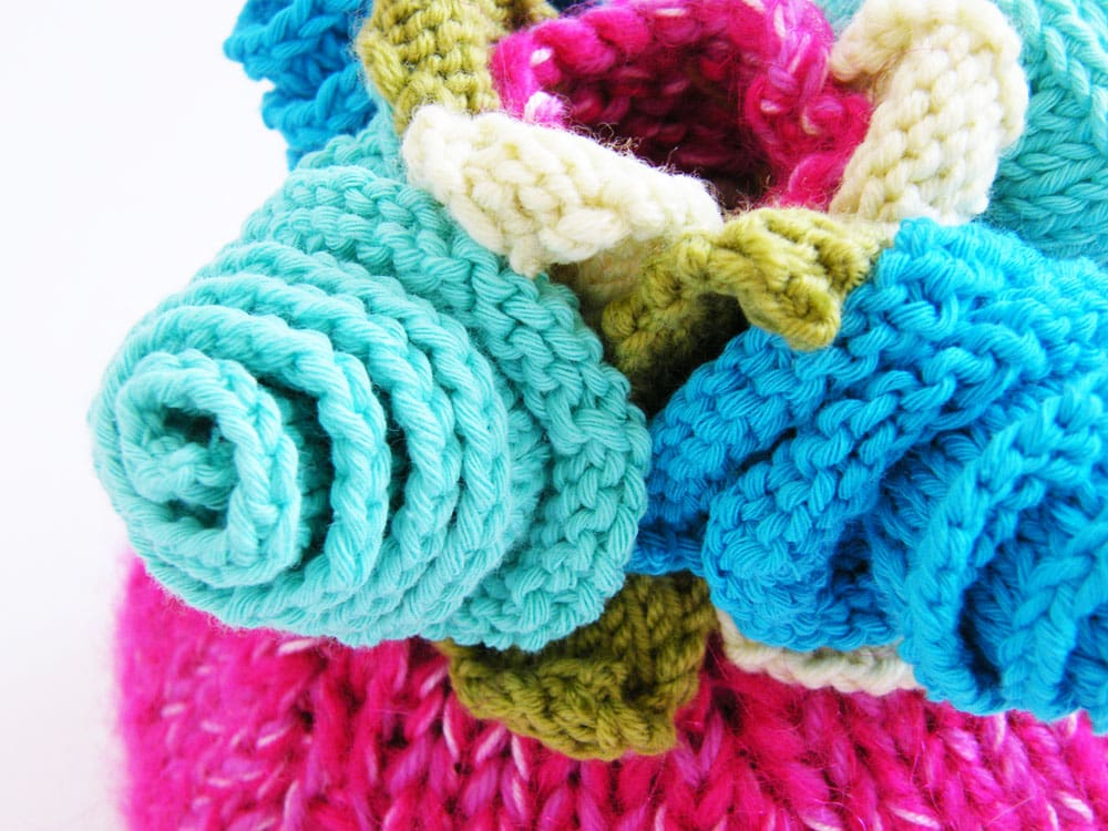 Turquoise knitted flowers close up