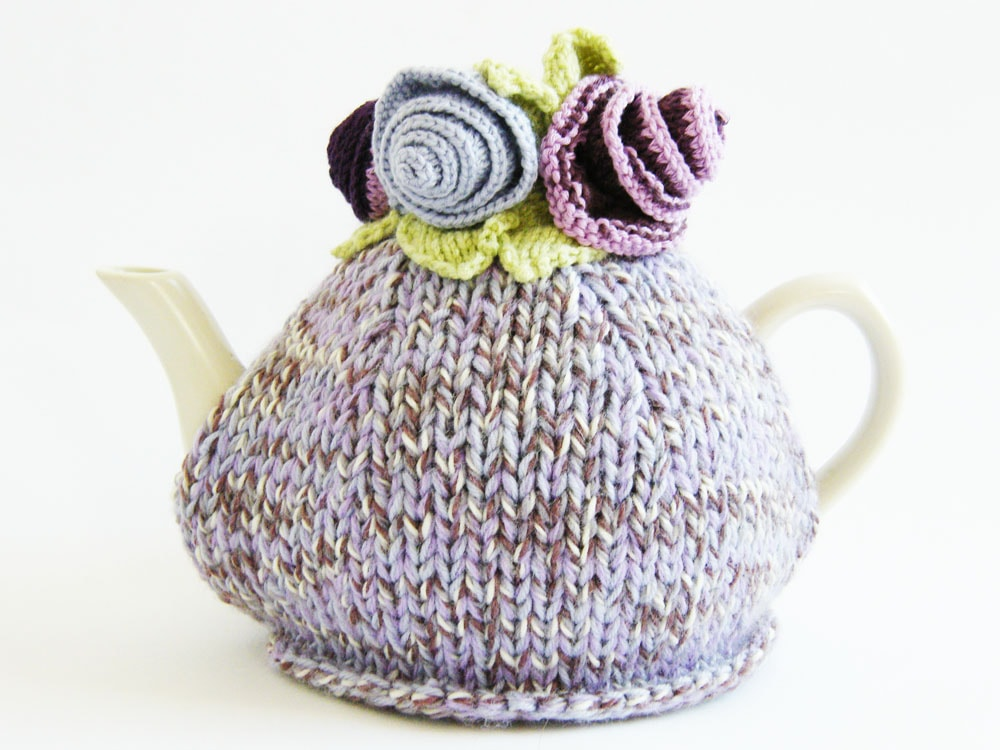 tea cozy with knitted flowers and leaves