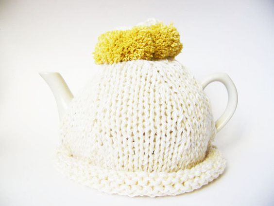 Mustard and white knit tea cosy