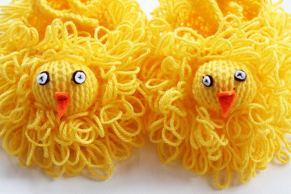 close up of knitted easter chick faces