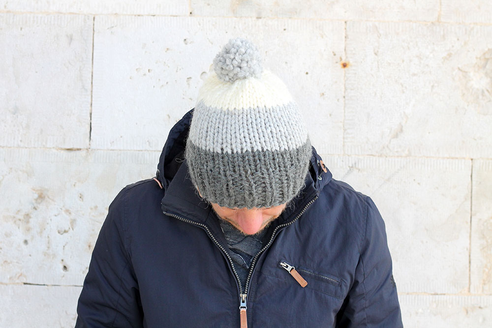 striped knitted men's hat with pom pom