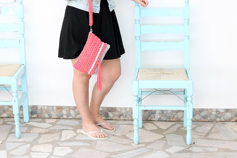 girl holding a crochet clutch bag