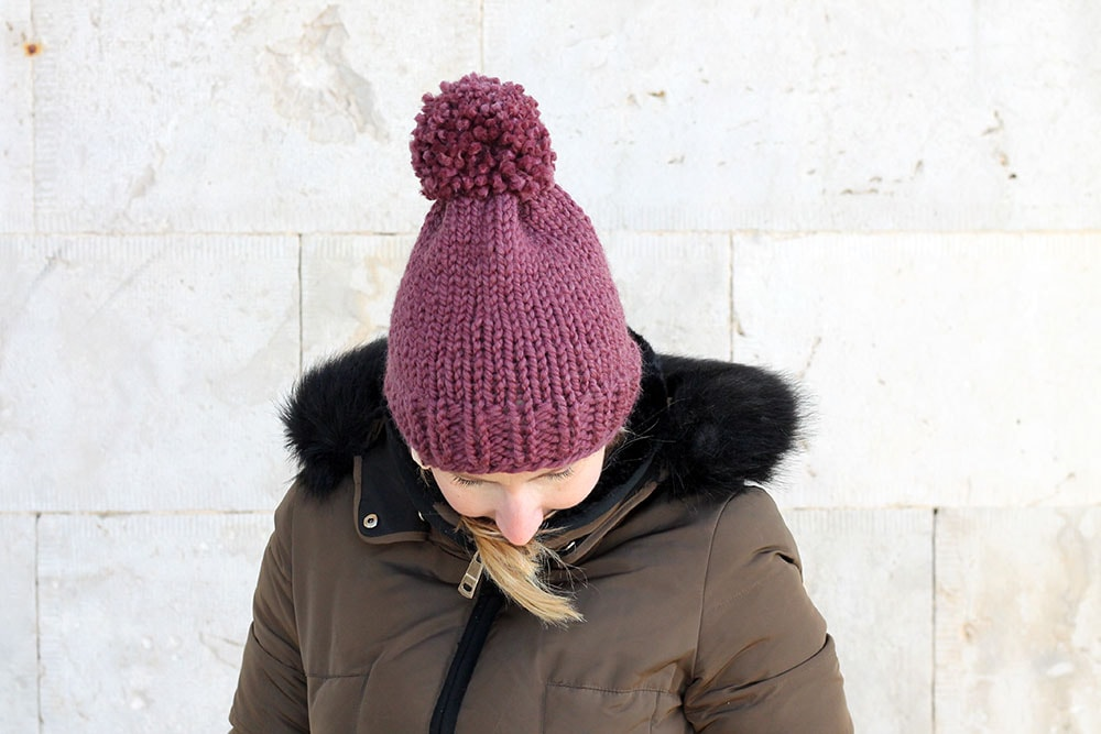 woman wearing a knit hat with a pom pom