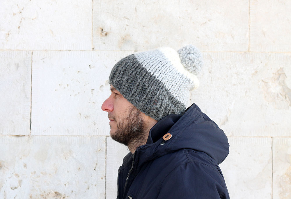 mens hat pattern with stripes and a pom pom