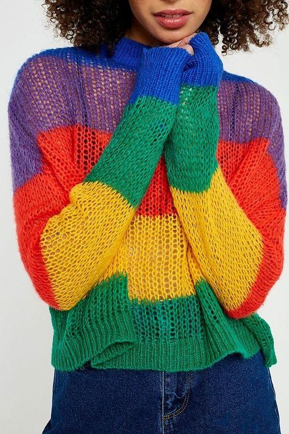 woman wearing a rainbow knit sweater
