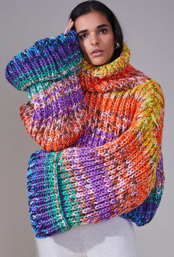 woman wearing an oversized knitted sweater