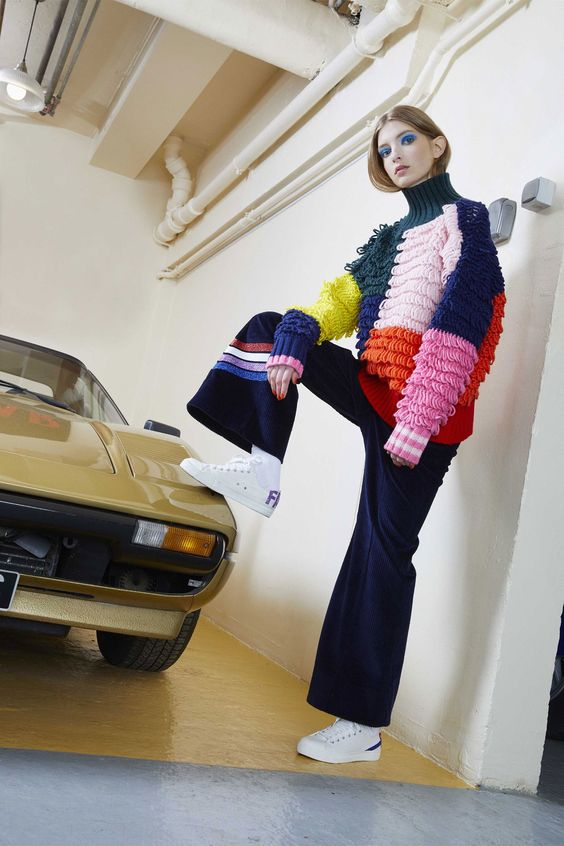 woman wearing a lopp knitted colourful sweater