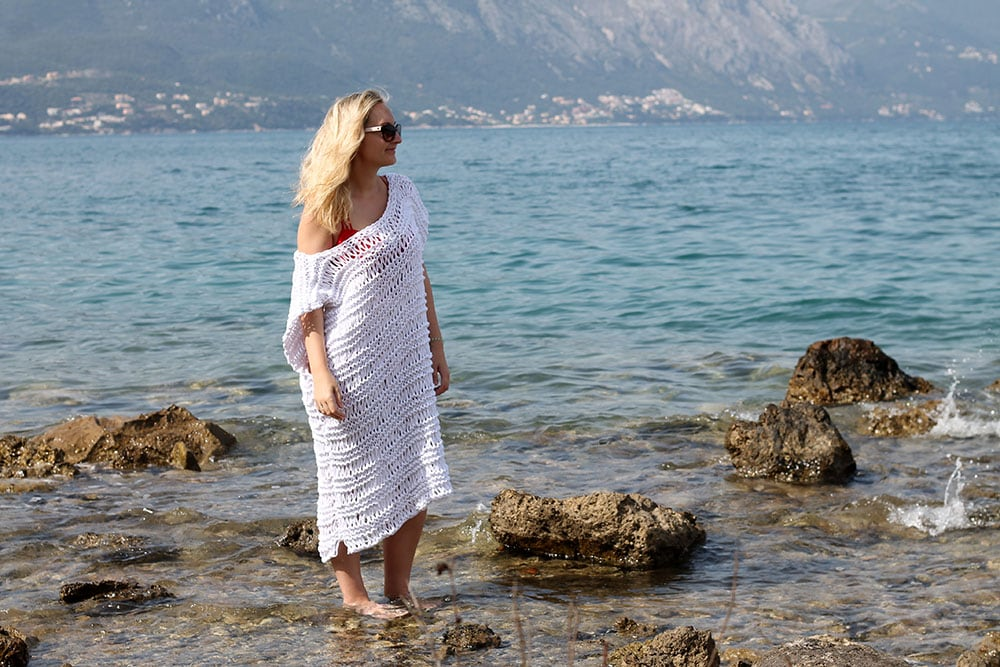 woman wearing a knitted beach dress