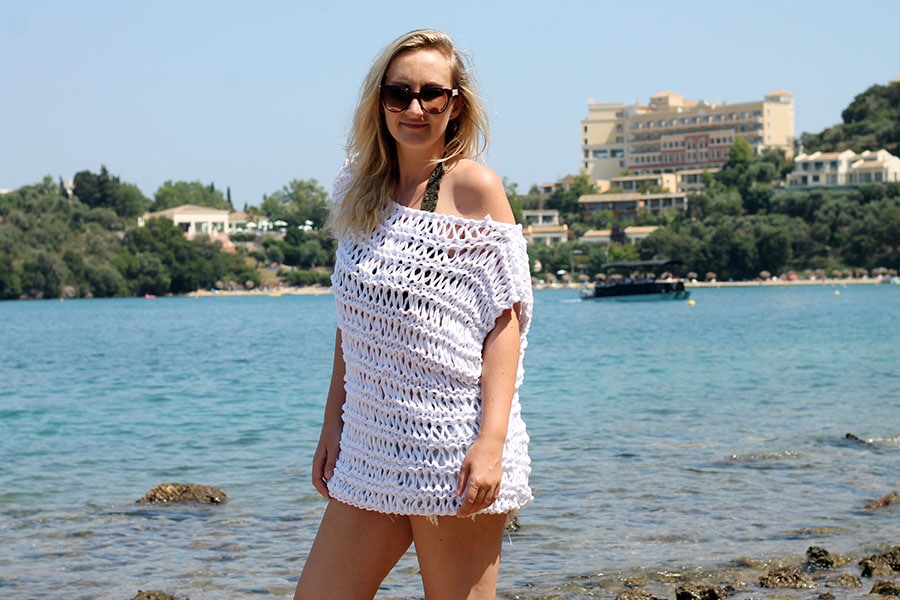 woman wearing a knitted beach cover up