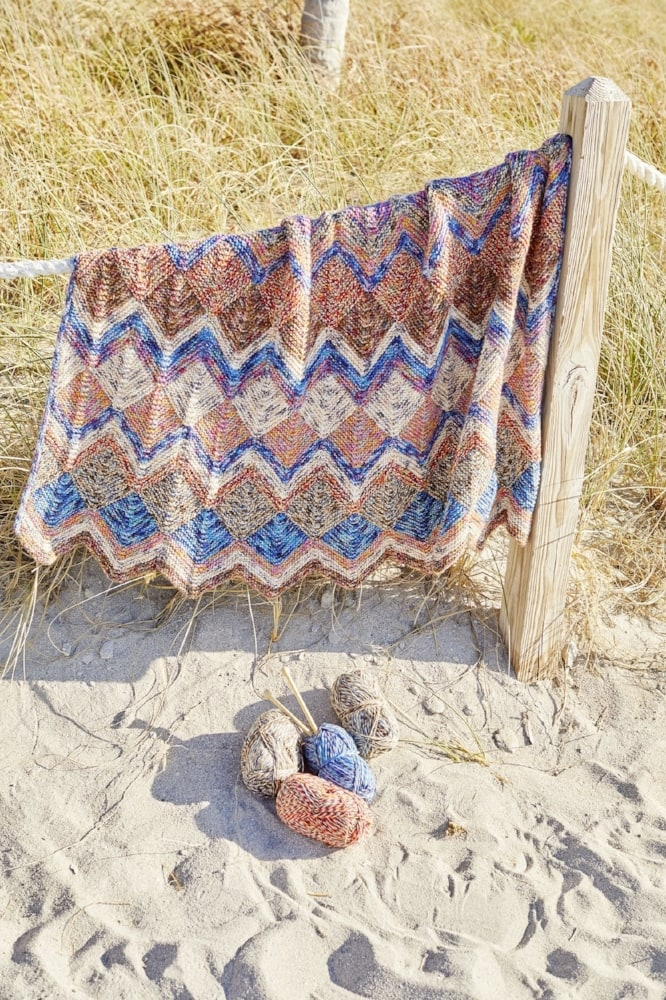 striped afghan at the beach