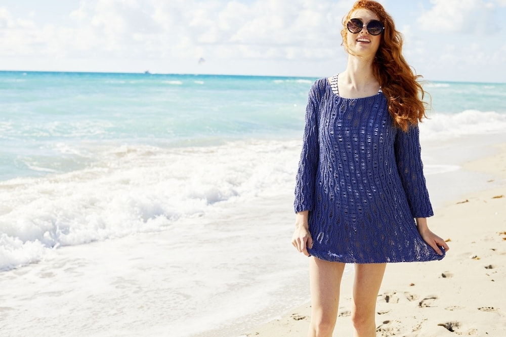 woman wearing a drop stitch pullover at the beach
