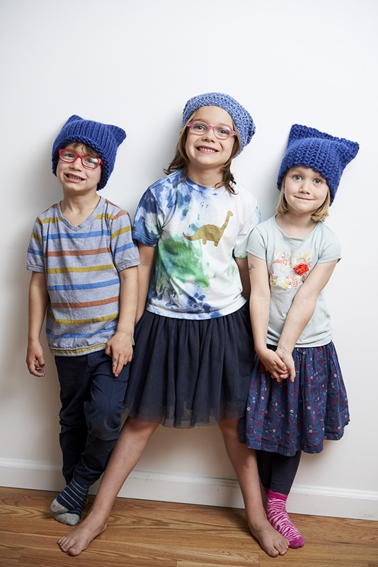 children wearing blue knitted cat hats