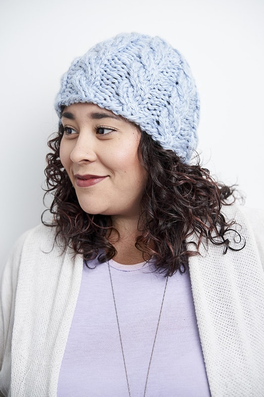 woman wearing a cable knit hat