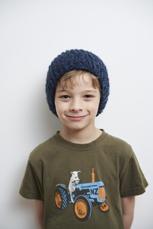 boy wearing a blue knitted beanie