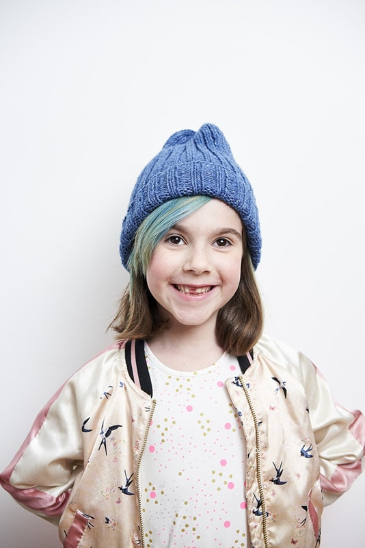 girl wearing a blue knit ribbed beanie