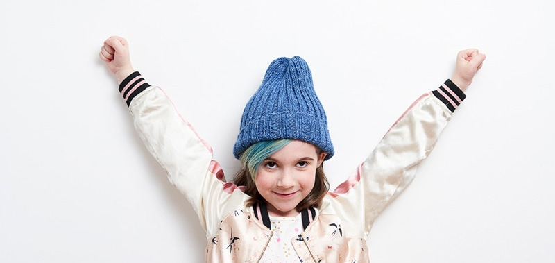 girl wearing a blue knitted hat