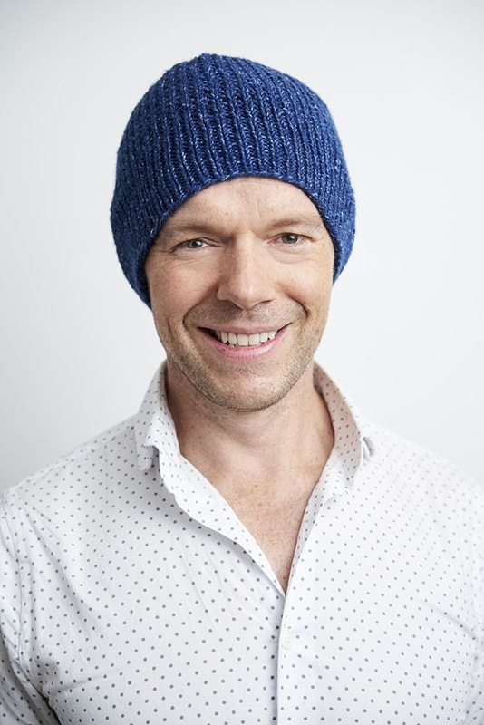 man wearing a blue knitted hat