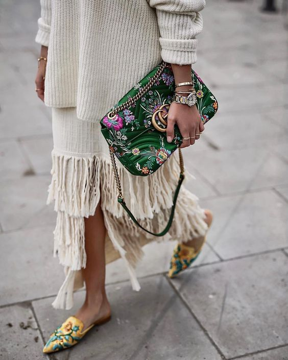 knitted sweater and fringing on skirt outfit