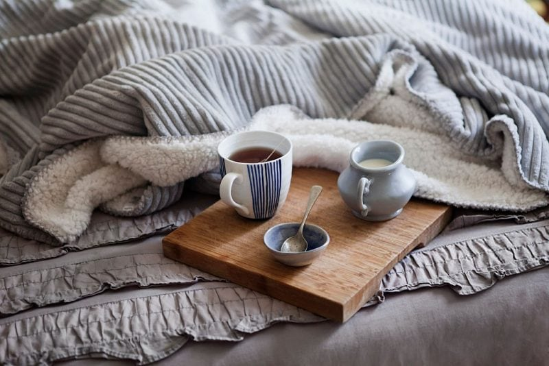 cosy blankets and coffee on a wooden tray