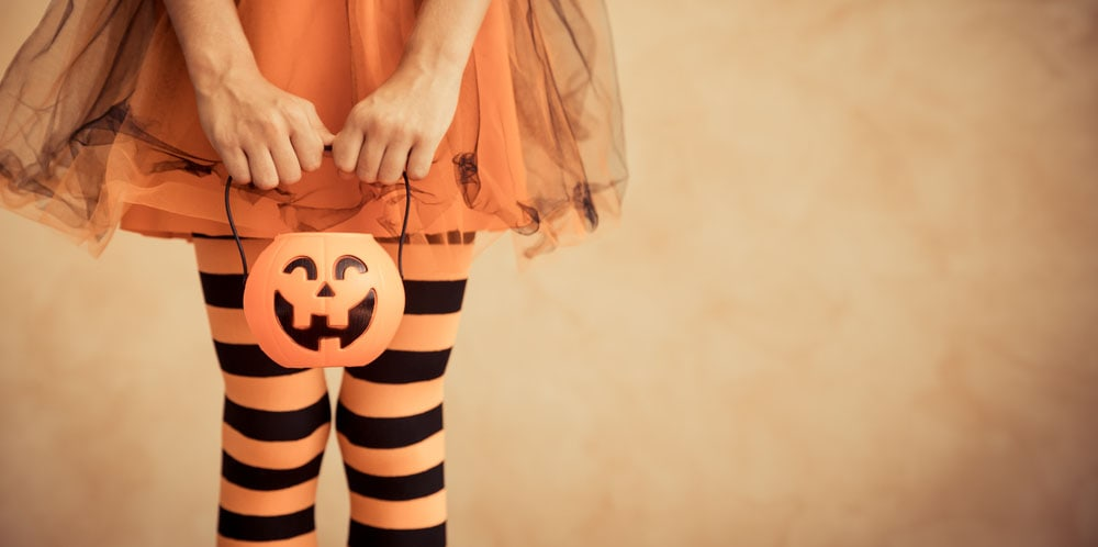 girl wearing orange and black striped tights