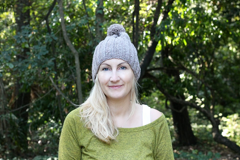 knitted ribbed beanie hat with pom pom