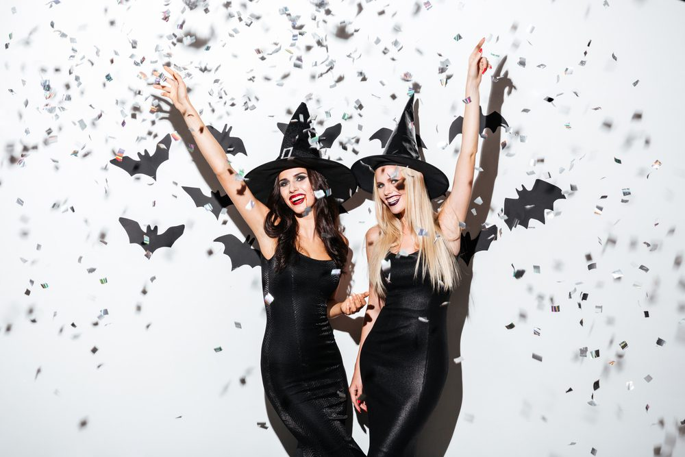 women dressed as witches with black bats