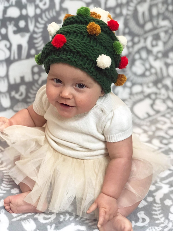 Baby Christmas tree hat knitted in green yarn