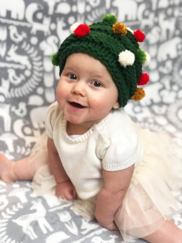 knitted baby Christmas tree hat with pom poms
