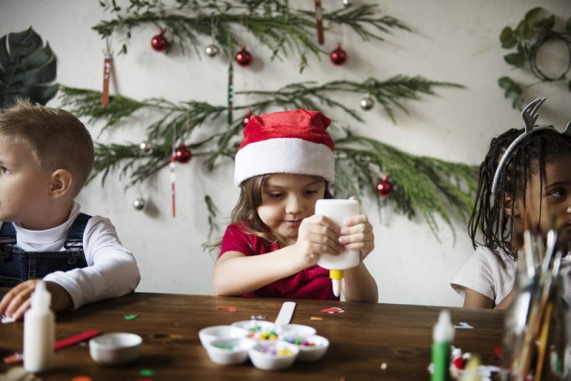 little girl making Christmas crafts