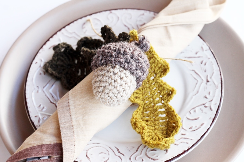 Crochet acorn and leaves tied to a napkin for Thanksgiving