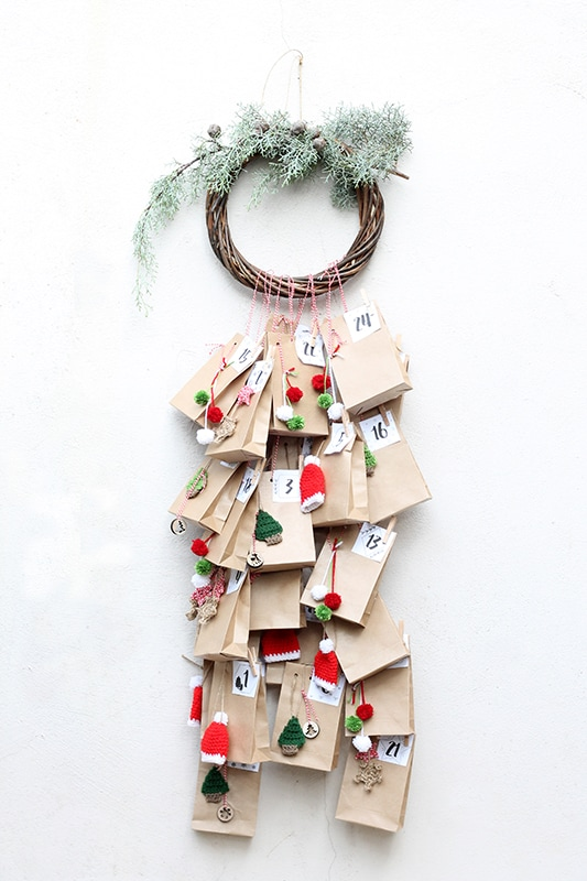 advent calendar with wreath and paper bags