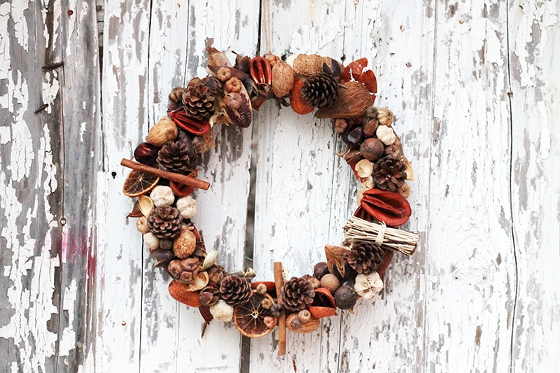 fall wreath hanging on a wooden door