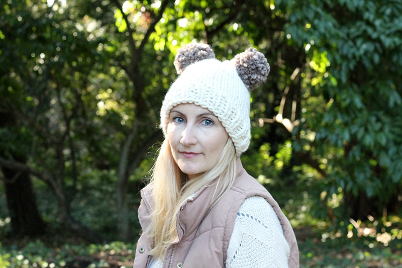front view of two pom pom knit hat