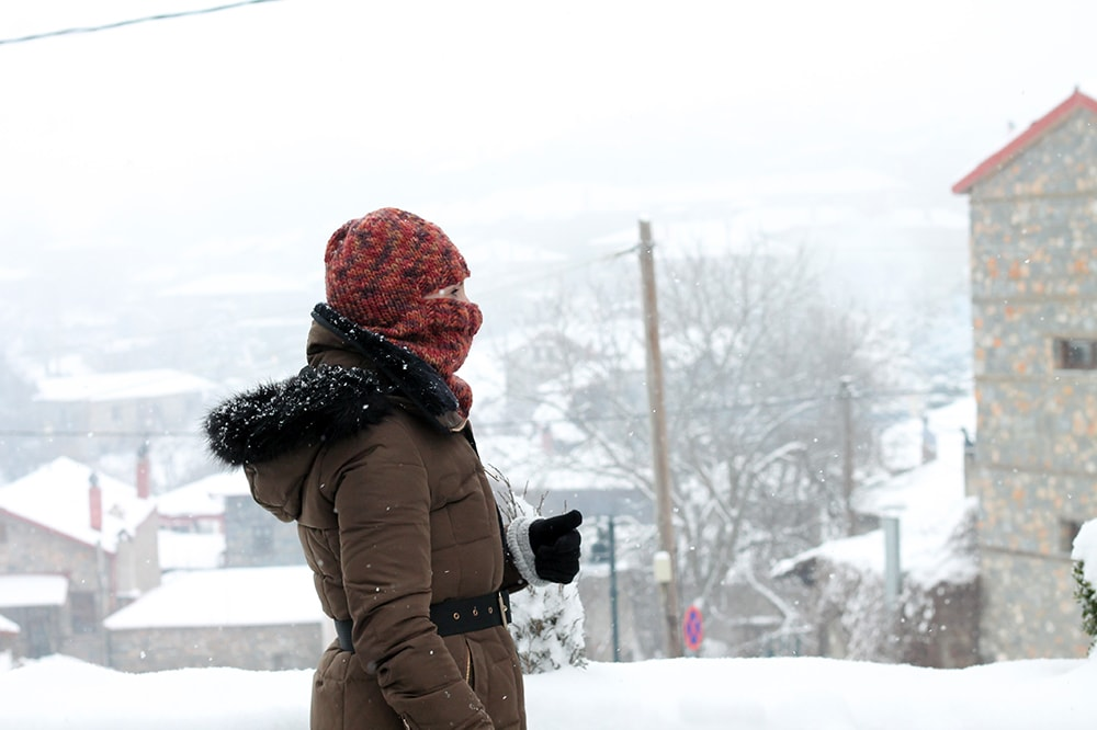 woman wearing a knitted balaclava in the snow