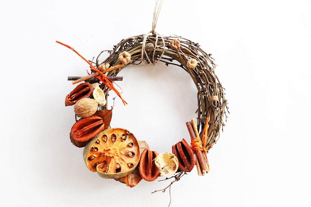 wooden door wreath with dried fruits