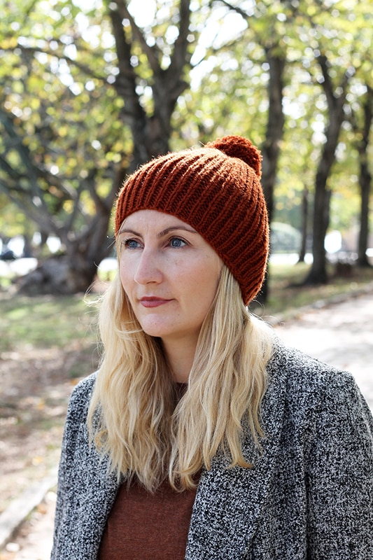 ribbed beanie knit in a rust coloured yarn