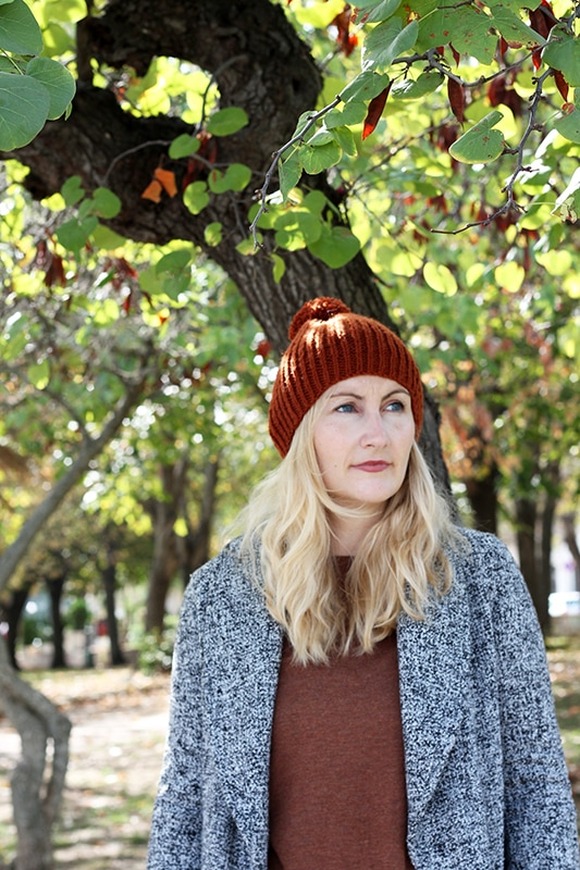 knit hat with pom pom in autumn