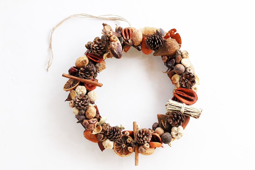 Fall door wreath made from pine cones and dried flowers