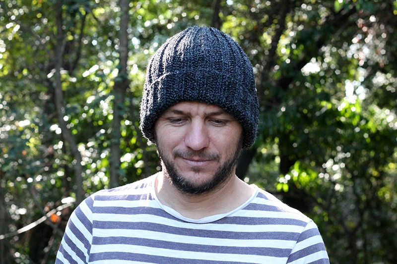 man wearing a knitted mariners hat