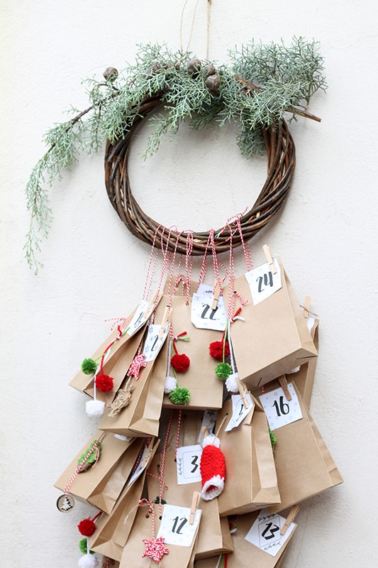 advent calendar with a wooden wreath decoration