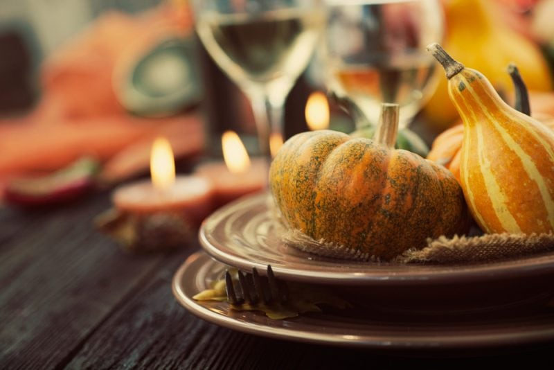 Thanksgiving table decor with pumpkins on plates