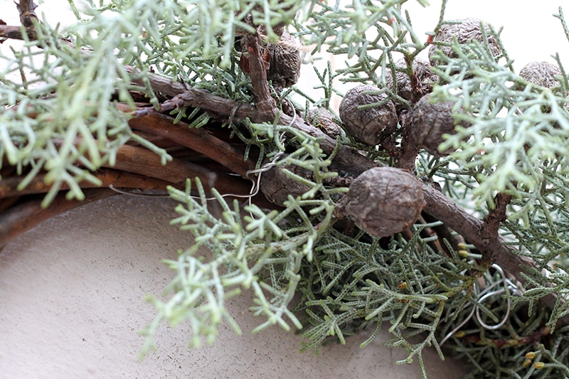 close up of wreath with pine branch