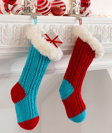 crochet Christmas stockings hanging on a white fireplace