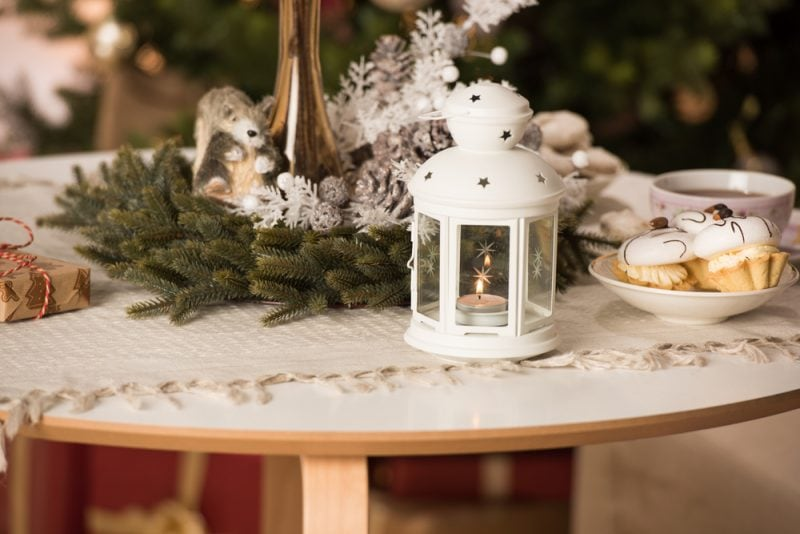 coffeee table with Christmas decorations and white lantern