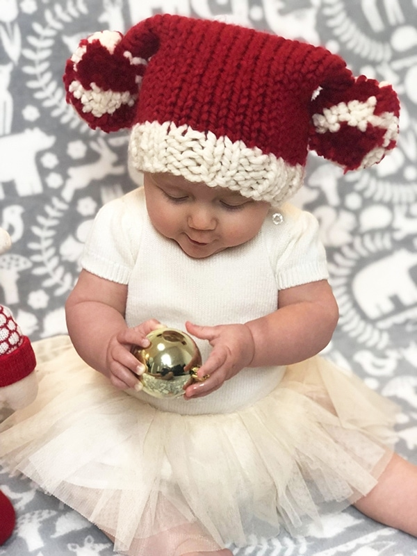 Baby Santa hat in red and white yarn with large pom poms