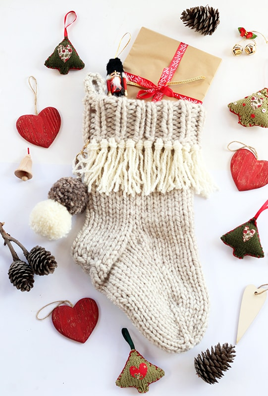 Christmas stocking with gifts and Christmas ornaments