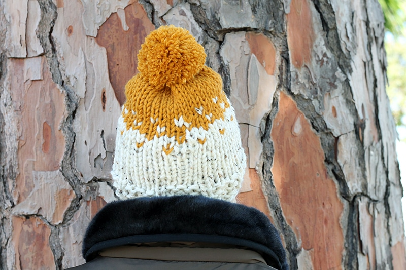 back view of the knit hat and pom pom