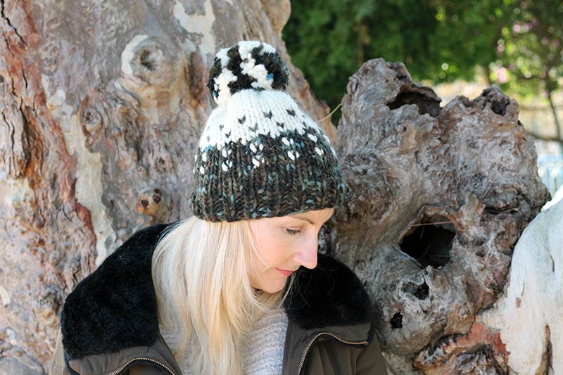 pom pom hat with a fair isle design