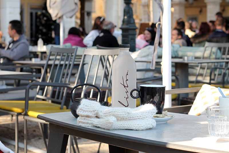 mittens on a table at the Liston cafe in Corfu Greece